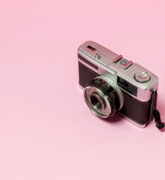 retro-styled-camera-pink-background_23-2148188250